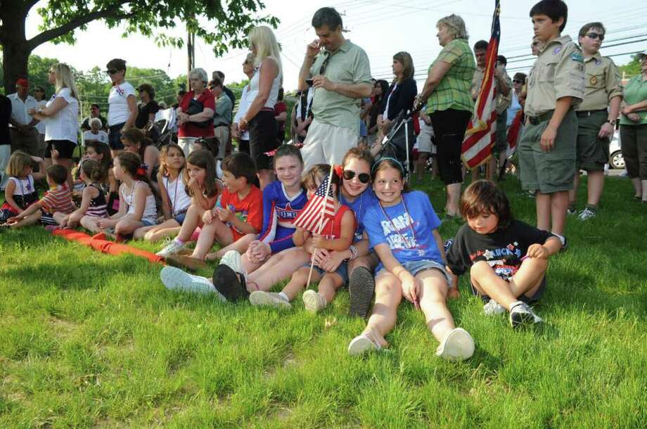 Families sitting at the ceremony after the Glenville Ninth District Veterans Association Memorial Day Parade on Sunday, May 29, 2011. Photo: Helen Neafsey / Greenwich Time