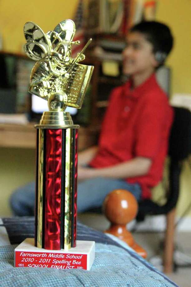 A trophy won by Mateen Sharif, 12, background right, of Guilderland, at his home on May 28, 2011. Sharif will represent Farnsworth Middle School, Guilderland, at the Scripps National Spelling Bee in Washington D.C. from May 31 through June 2. (Erin Colligan / Special To The Times Union)