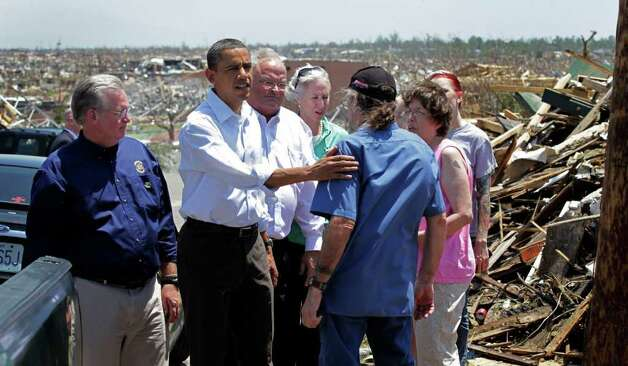 President Barack Obama, second from left, seen with officials and residents, views damage from the tornado that devastated Joplin, Mo., Sunday, May 29, 2011.  He is joined by Missouri Gov. Jay Nixon.  (AP Photo/J. Scott Applewhite) Photo: J. Scott Applewhite