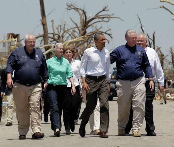 President Barack Obama views damage from the tornado that devastated Joplin, Mo., Sunday, May 29, 2011. Obama is joined by Missouri Gov. Jay Nixon, second from right, and FEMA Director William Fugate, left. (AP Photo/J. Scott Applewhite) Photo: J. Scott Applewhite