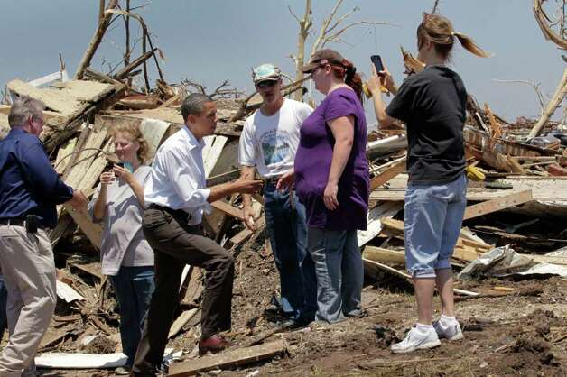 President Barack Obama, third from left, talks with residents while viewing damage from the tornado that devastated Joplin, Mo., Sunday, May 29, 2011.   (AP Photo/J. Scott Applewhite) Photo: J. Scott Applewhite