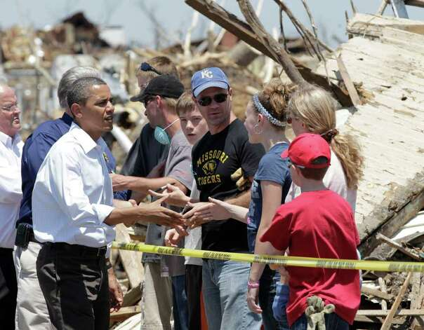 President Barack Obama talks to residents and views damage from the tornado that devastated Joplin, Mo., Sunday, May 29, 2011.   (AP Photo/J. Scott Applewhite) Photo: J. Scott Applewhite