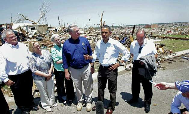 President Barack Obama views damage from the tornado that devastated Joplin, Mo., Sunday, May 29, 2011.  (AP Photo/J. Scott Applewhite) Photo: J. Scott Applewhite