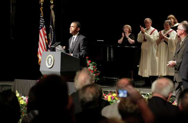President Barack Obama speaks at a memorial service at Missouri Southern State University for the victims of the tornado that devastated Joplin, Mo., Sunday, May 29, 2011.  (AP Photo/J. Scott Applewhite) Photo: J. Scott Applewhite
