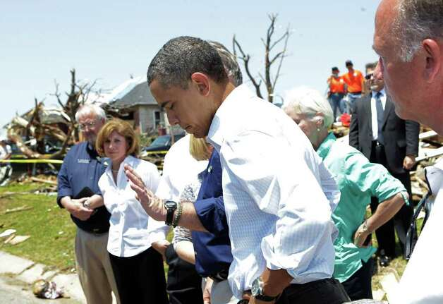 President Barack Obama reacts to comments on the damage from the tornado that devastated Joplin, Mo., Sunday, May 29, 2011.   (AP Photo/J. Scott Applewhite) Photo: J. Scott Applewhite