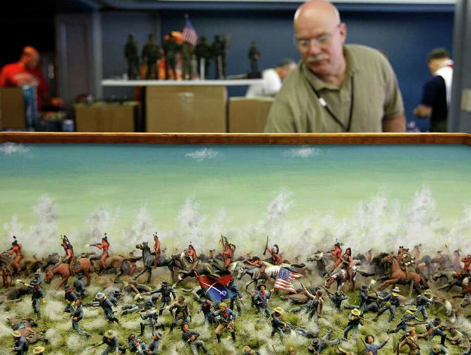 """Mike Luteran, (cq), of Hubbard, OH, works behind his """"Custer's Last Stand"""" diorama while participating in the fifth annual Texas Toy Soldier Show, at the Menger Hotel, Sunday, May 29, 2011. JERRY LARA/glara@express-news.net Photo: JERRY LARA, Jerry Lara/Express-News / SAN ANTONIO EXPRESS-NEWS"""