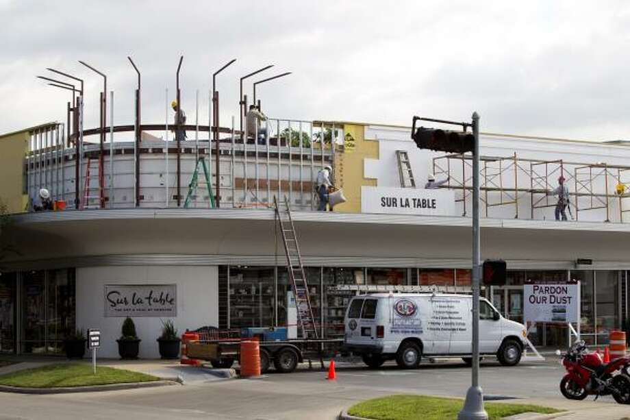 Workers continue renovations to the shopping center on West Gray near Shepherd. Photo: Brett Coomer, Houston Chronicle
