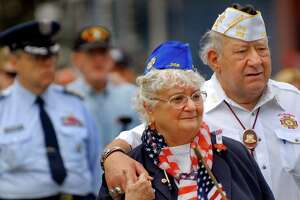 Jean Starks, representing the Gold Star Mothers, center, and her husband, VFW Post 358 past commander Bob Starks attend the the Memorial Day service following the parade on Saturday, May 28, 2011, in Ballston Spa, N.Y. (Cindy Schultz / Times Union)