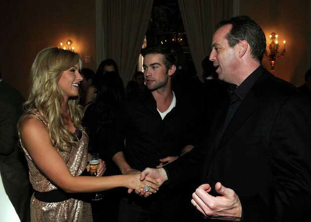 WASHINGTON - APRIL 30:  (L-R) Journalist Candice Crawford, actor Chace Crawford and Paul Caine, President of People Magazine attend the PEOPLE/TIME party on the eve of the White House Correspondents' Dinner at the St Regis Hotel - Astor Terrace on April 30, 2010 in Washington, DC.  (Photo by Larry Busacca/Getty Images for Time Inc) *** Local Caption *** Candice Crawford;Chace Crawford;Paul Caine Photo: Larry Busacca, Getty Images For Time Inc / 2010 Getty Images
