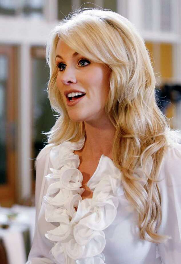 Candice Crawford is photographed at the 2011 Spring Luncheon benefiting Nexus Recovery Center, Thursday, May 12, 2011, in Dallas. Crawford, a former local sports reporter who is engaged to Dallas Cowboys quarterback Tony Romo, interviewed Barbara Pierce Bush and Jenna Bush Hager during the annual event. Photo: AP