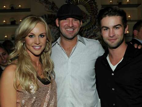 WASHINGTON - APRIL 30: (L-R) Journalist Candice Crawford, NFL player Tony Romo and actor Chace Crawford attend the PEOPLE/TIME party on the eve of the White House Correspondents' Dinner at the St Regis Hotel - Astor Terrace on April 30, 2010 in Washington, DC. Photo: Larry Busacca, Getty Images / 2010 Getty Images