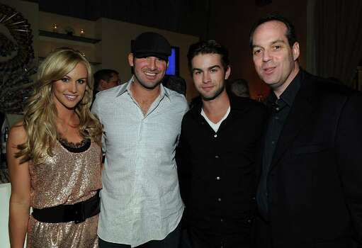 WASHINGTON - APRIL 30:  (L-R) Journalist Candice Crawford, NFL player Tony Romo, actor Chace Crawford and Paul Caine attend the PEOPLE/TIME party on the eve of the White House Correspondents' Dinner at the St Regis Hotel - Astor Terrace on April 30, 2010 in Washington, DC. Photo: Larry Busacca, Getty Images / 2010 Getty Images