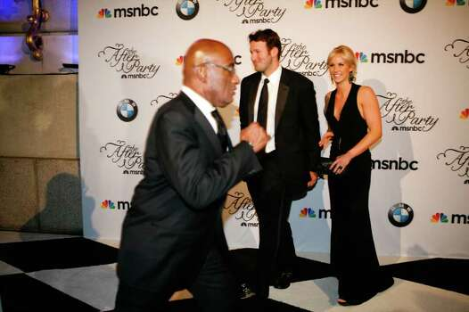 WASHINGTON - MAY 01: Dallas Cowboys quarterback Tony Romo and his girlfriend Candice Crawford arrive at the MSNBC Afterparty following the White House Correspondents' Association dinner as Al Roker runs in front of them on May 1, 2010 in Washington, DC. The annual dinner featured comedian Jay Leno and was attended by President Barack Obama and First Lady Michelle Obama. Photo: Brendan Hoffman, Getty Images / 2010 Getty Images