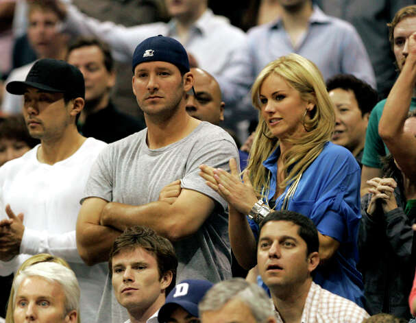 Dallas Cowboys quarterback Tony Romo, left, sits with Candice Crawford during the second half of an NBA basketball game of the Dallas Mavericks and the Oklahoma City Thunder in Dallas, April 3, 2010. (AP Photo/Mike Fuentes) Photo: Associated Press / AP2010