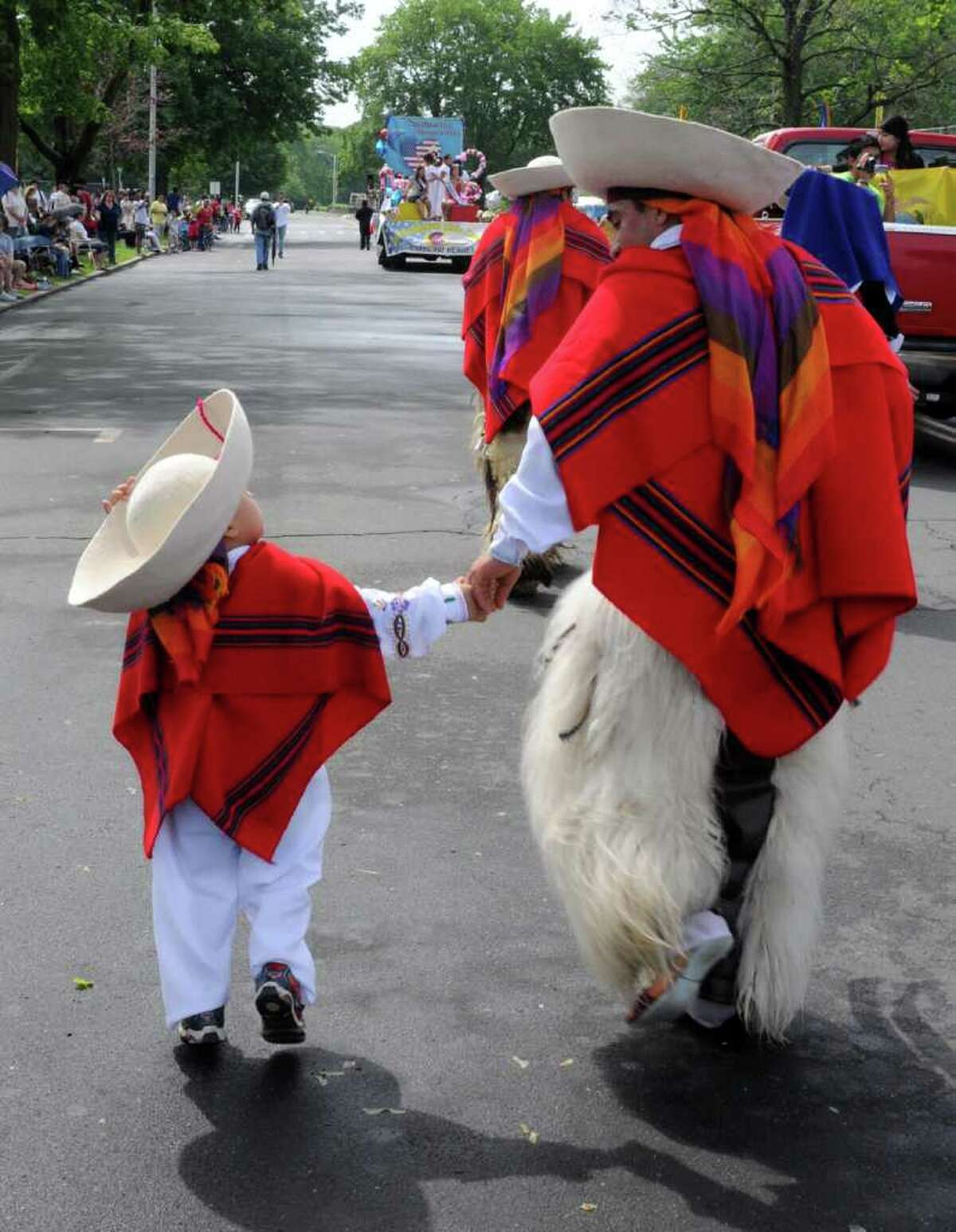 Rodrigo Rivera, 3, and his father Angel, both of Danbury, dance in the Danbury Memorial Day Parade on Monday May 30, 2011 with the Sumac Pakarina, traditional Equadorian dancers.