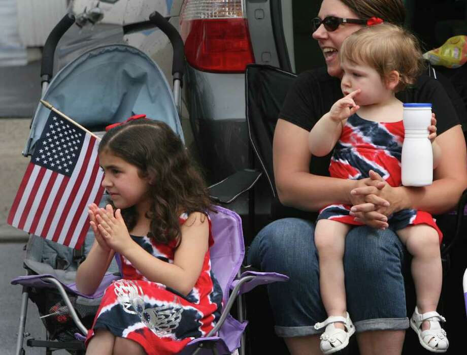 Sue Fekete watches the Fairfield Memorial Day Parade  parade with her daughters, Emma, 6, and Julia, 17 mos., on Monday, May 30, 2011. Photo: B.K. Angeletti / Connecticut Post