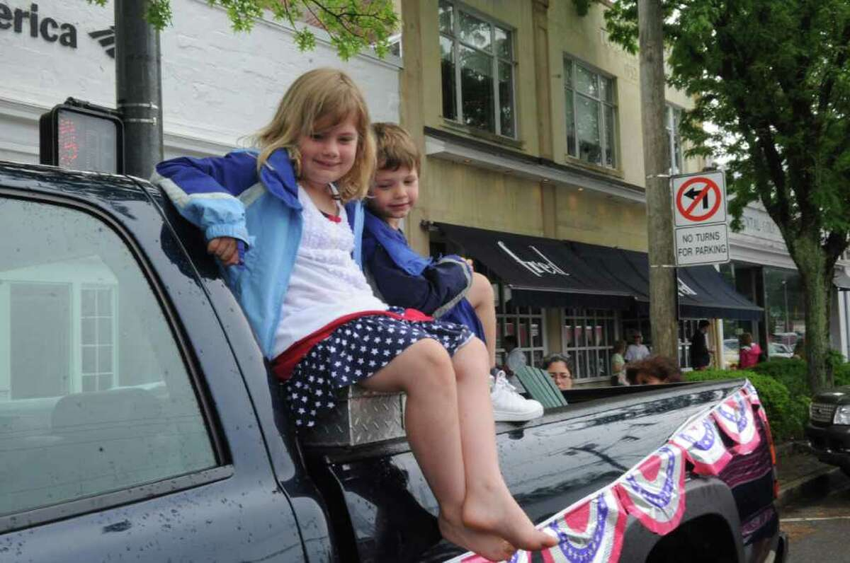 Piper Gilbert, 7, and her brother Reed, 5 watch the Old Greenwich Memorial Day Parade down Sound Beach Avenue on Monday, May 30, 2011.