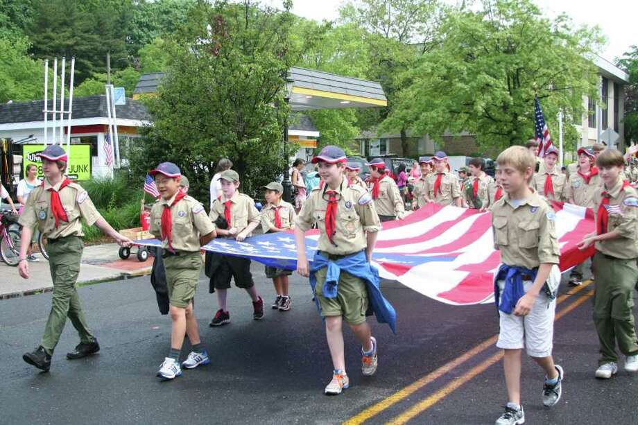 Scouts from Troop 35 carry a large American flag during Monday morning's Memorial Day Parade in Darien. Kristen Riolo for the Darien News. Photo: Contributed Photo / Darien News