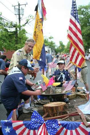 Henry Domenici and John Phipps of Scout Troop No. 55 grab their skewers with marshmallows for the troop's float during Darien's Memorial Parade Monday morning. Kristen Riolo for the Darien News. Photo: Contributed Photo / Darien News