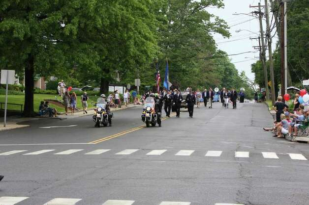 The rain cleared in time for the Memorial Day Parade Monday morning, which was led by the Darien Police Department. Kristen Riolo for the Darien News. Photo: Contributed Photo / Darien News