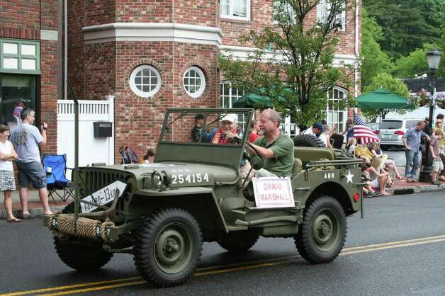 Grand Marshal Bill Flanagan in the passenger seat during Darien's Memorial Day Parade Monday morning. Kristen Riolo for the Darien News Photo: Contributed Photo / Darien News