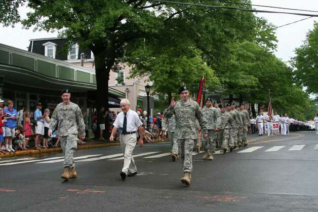 Members of the Connecticut National Guard march in Darien's annual Memorial Day Parade Monday morning. Kristen Riolo for the Darien News Photo: Contributed Photo / Darien News