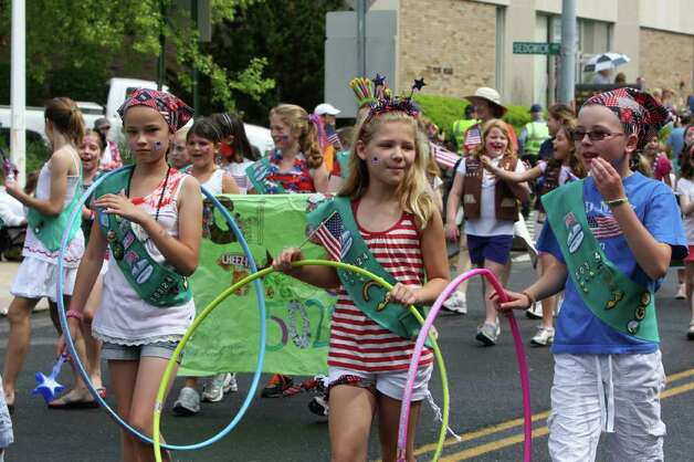 Girl Scout Troop 50324 participate in Darien's annual Memorial Day Parade Monday. Kristen Riolo for the Darien News Photo: Contributed Photo / Darien News