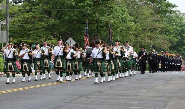 Bagpipes lead the way for Noroton Fire Department in Darien's Memorial Day Parade Monday morning. Kristen Riolo for the Darien News Photo: Contributed Photo / Darien News
