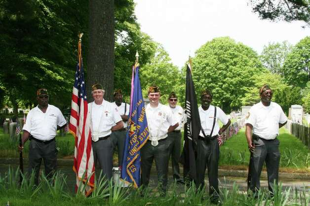 Members of VFW Post 6933 Color Guard participate in Darien's annual Memorial Day ceremonies. Kristen Riolo for the Darien News Photo: Contributed Photo / Darien News