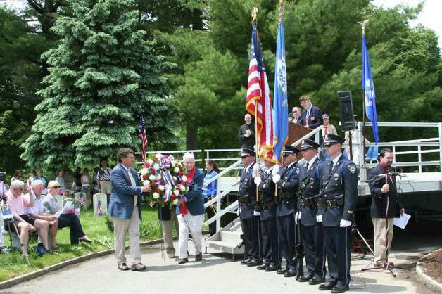 First Selectman Dave Campbell and Grand Marshal Bill Flanagan place the Memorial Day wreath during Monday's ceremonies. Kristen Riolo for the Darien News Photo: Contributed Photo / Darien News