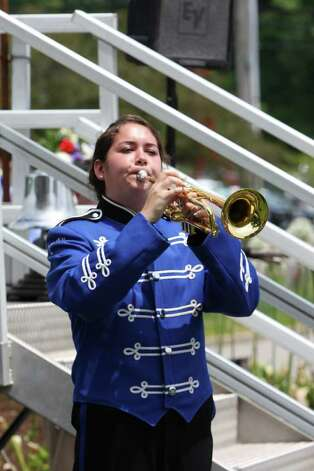 "Kristin Carey, a member of the Darien High School band, play ""Taps"" at the Memorial Day ceremony. Kristen Riolo for the Darien News Photo: Contributed Photo / Darien News"