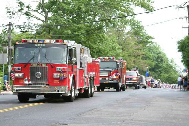 The Noroton Fire Department follows the Memorial Day Parade route Monday morning. Kristen Riolo for the Darien News Photo: Contributed Photo / Darien News