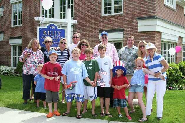 Family and friends from Kelly Associates came out to celebrate Memorial Day Monday morning. Kristen Riolo for the Darien News Photo: Contributed Photo / Darien News