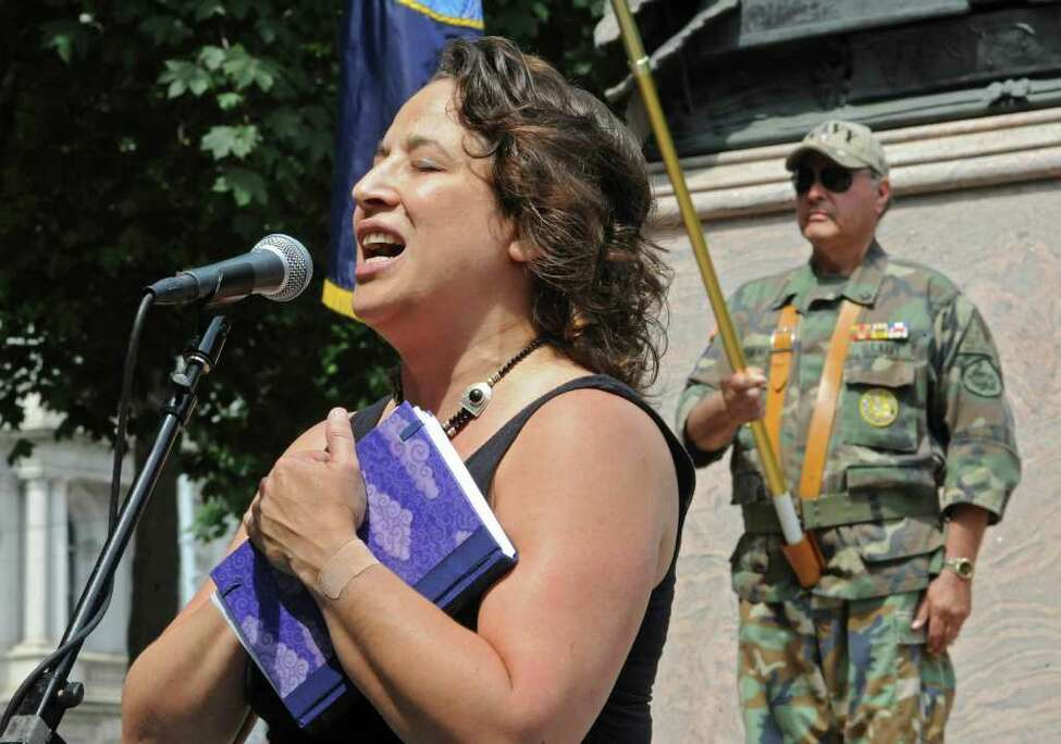 Caroline Isachsen, aka MotherJudge, sings the national anthem during a Memorial Day ceremony held at Lafayette Park after the 2011 Albany Memorial Day Parade in Albany. (Lori Van Buren / Times Union)