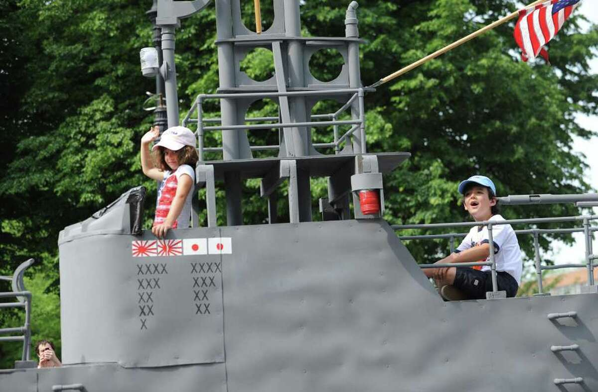 Daughter and son of Grand Marshal Thomas Buchanan, commanding officer, U.S.S. Albany, Anita Buchanan, 7, and Brian Buchanan, 5, of Virgini,a ride a submarine float the Albany Memorial Day Parade in Albany, N.Y. Monday May 30, 2011. (Lori Van Buren / Times Union)