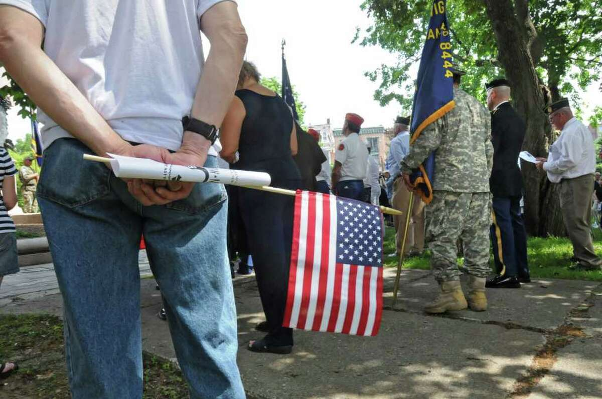 People attend a Memorial Day ceremony held at Lafayette Park after the Albany Memorial Day Parade in Albany, N.Y. Monday May 30, 2011. a (Lori Van Buren / Times Union)
