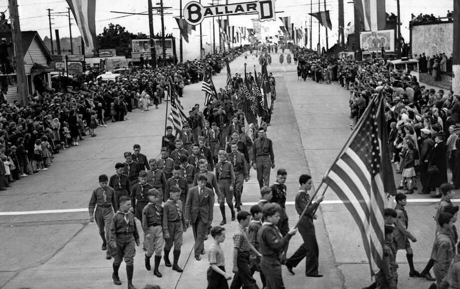 The May 1940 photo caption read: Part of the Boy Scout contingent in the procession, turning off the bridge into Ballard Way for the long hike to the reviewing stand. Photo: Seattlepi.com File