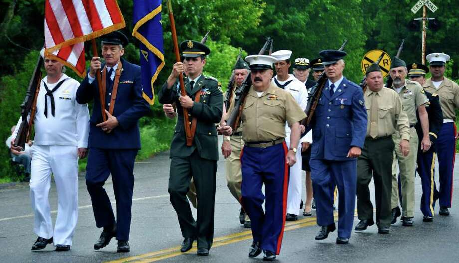 SPECTRUM/The color guard shows the way as Kent's Memorial Day parade steps off Monday, shortly after a thunderstorm had passed through town. May 30, 2011 Photo: Cristina Bernardi / The News-Times Freelance