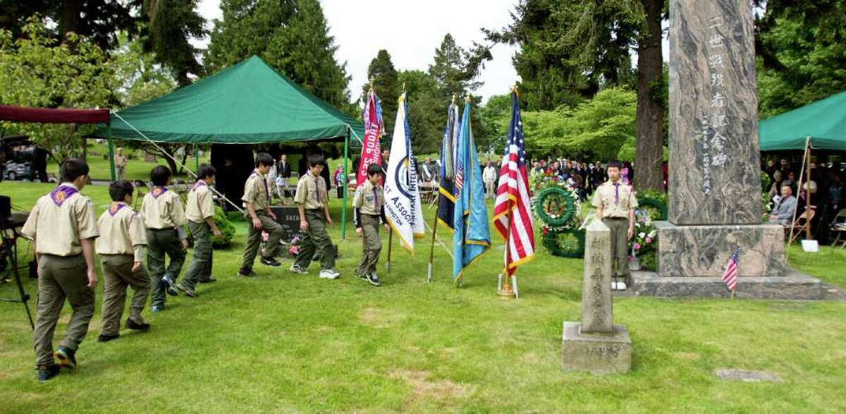 Boy Scout Troop 252 retires the colors at the Nisei Veteran memorial service at Seattle's Lake View Cemetery on Memorial Day.