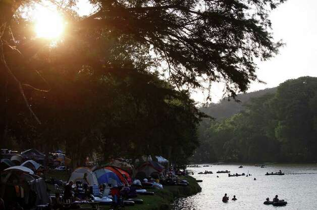 Tubers float the Guadalupe River while campers fill the banks  near Gruene on Saturday, May 28, 2011. LISA KRANTZ/lkrantz@express-news.net Photo: LISA KRANTZ, Lisa Krantz/Express-News / SAN ANTONIO EXPRESS-NEWS