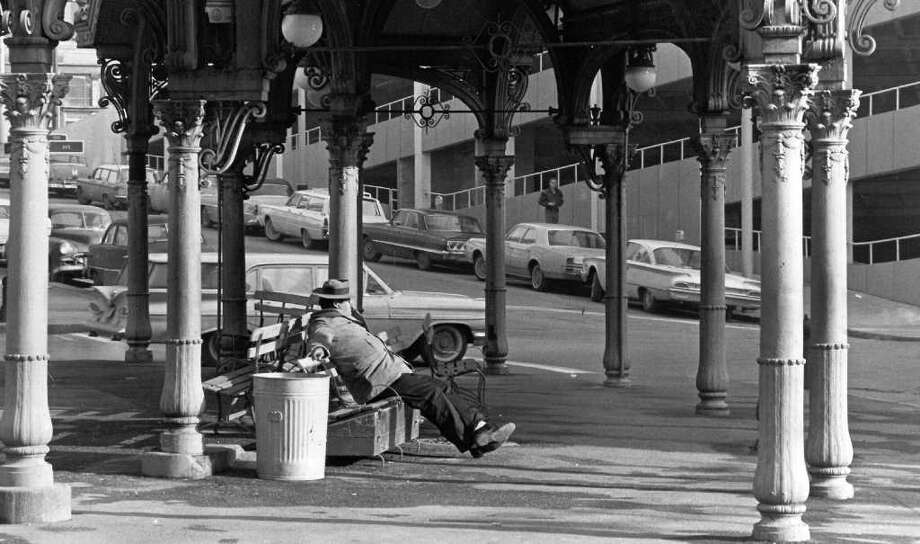 Man precched on a bench in Pioneer Square, Jan. 10, 1965. Photo: Seattlepi.com File / seattlepi.com
