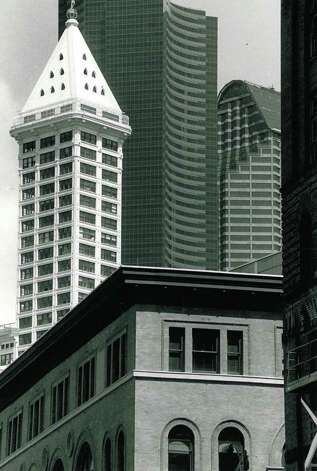 The May 1991 photo captino read: A sweeping view from Pioneer Square spans a century of architecture from the 1890s Burke Building to the 1914 Smith Tower to the 1984 Columbia Tower. Photo: Seattlepi.com File / seattlepi.com