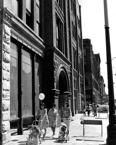 Suburbanites walk through, shop in Pioneer Square. June 12, 1972.