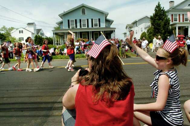 Dawn Monteiro and Julia Lihv (10) watch the Norwalk, Conn. Memorial Day Parade on Monday May 30, 2011. Photo: Dru Nadler / Stamford Advocate Freelance