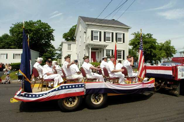 Soldiers who served on the USS Missouri ride in a float at the Norwalk, Conn. Memorial Day Parade on Monday May 30, 2011. Photo: Dru Nadler / Stamford Advocate Freelance