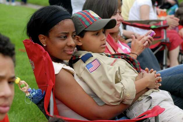 Gabrielle Massa nad her son Tristan (10) watch the Norwalk, Conn. Memorial Day Parade on Monday May 30, 2011. Photo: Dru Nadler / Stamford Advocate Freelance