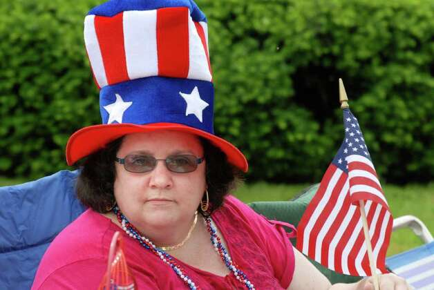 Irene Siedlarczyk from Endicott, NY watches the Norwalk, Conn. Memorial Day Parade on Monday May 30, 2011, her father served on the USS Missouri in WW 11 and was in the parade. Photo: Dru Nadler / Stamford Advocate Freelance