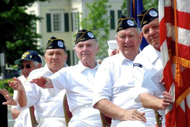 Soldiers who served on the USS Missouri ride on a float at the Norwalk, Conn. Memorial Day Parade on Monday May 30, 2011. Photo: Dru Nadler / Stamford Advocate Freelance