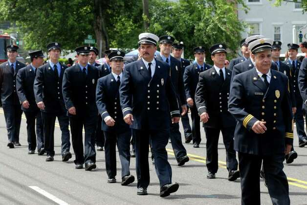 The Norwalk Fire Department marches at the Norwalk, Conn. Memorial Day Parade on Monday May 30, 2011. Photo: Dru Nadler / Stamford Advocate Freelance