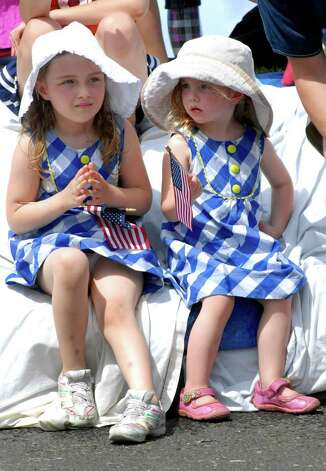 Mercedes (6) and Lily (3) Skidd watch the Norwalk, Conn. Memorial Day Parade on East Ave. on Monday May 30, 2011. Photo: Dru Nadler / Stamford Advocate Freelance